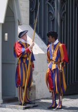 Two Papal Swiss Guards in traditional uniforms (yellow, orange, and red stripes). Photograph by Greatpatton of the French Wikipedia and used under the Creative Commons Attribution ShareAlike 1.0 license.